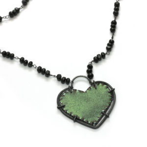 green and black enamel heart necklace